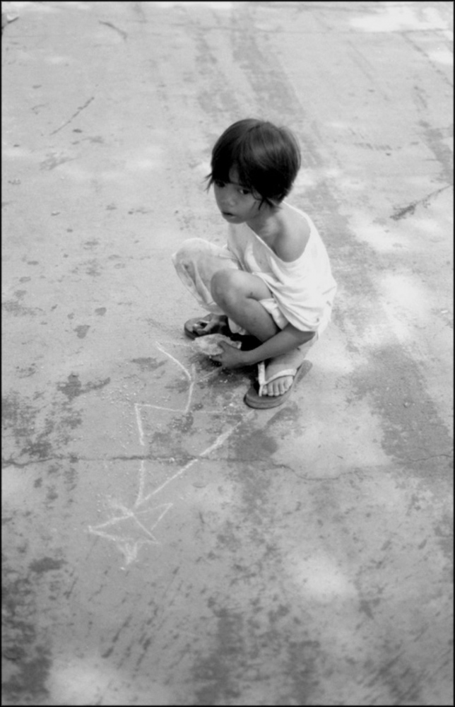 Young Girl and Chalk Drawing, South Cemetery, Manila, Philippines, November 2005