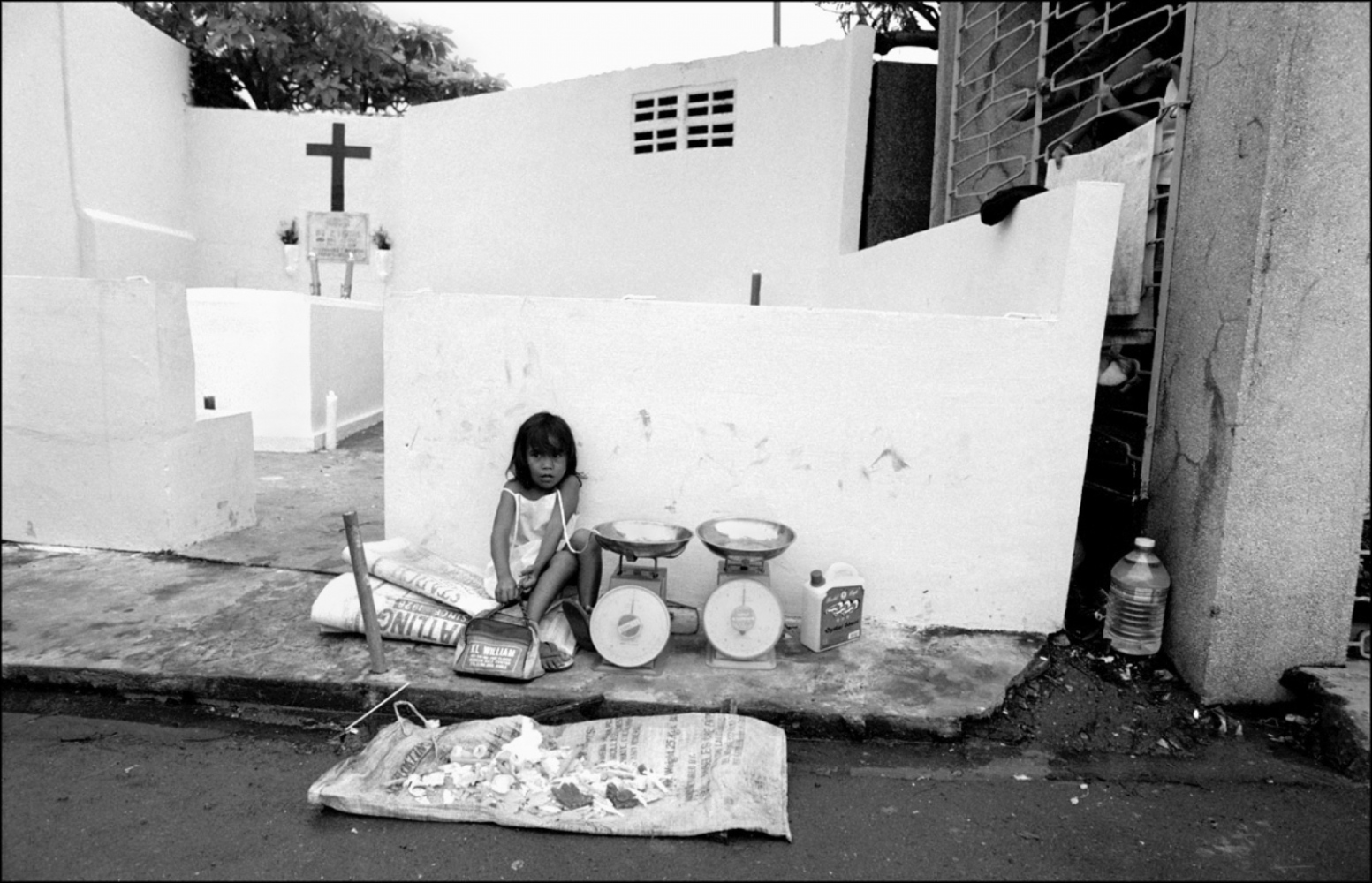 Girl Selling Candle Wax, North Cemetery, Manila, Philippines, November 2005