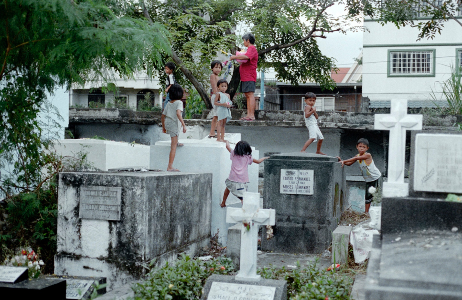 Kids Playing on Graves, South Cemetery, Manila, Philippines, November 2005
