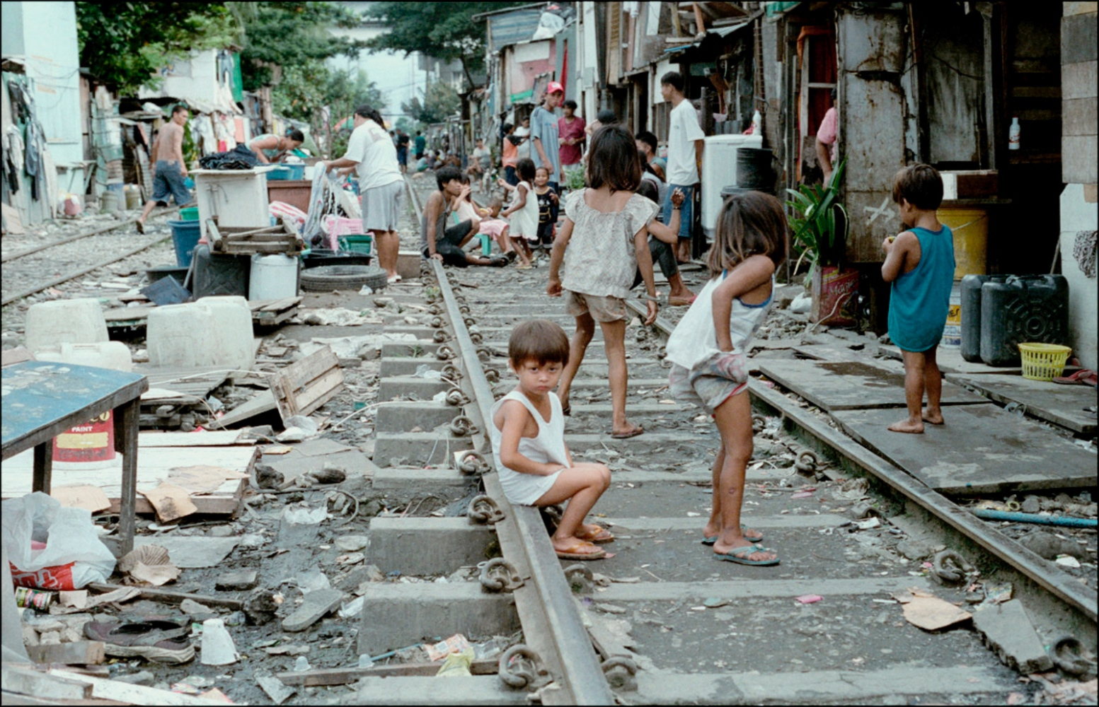 Child Sitting on Train Tracks, San Andreas Bridge, Manila, Philippines, November 2005