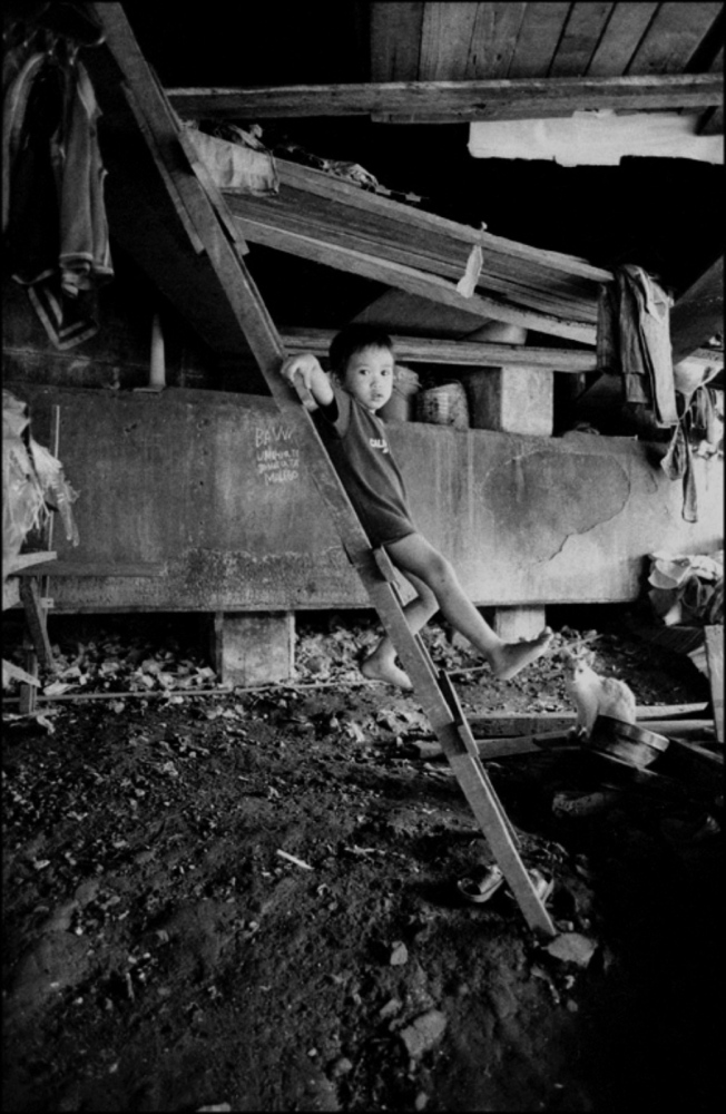 Boy Standing on Ladder, Pandacan Bridge, Manila, Philippines, November 2005
