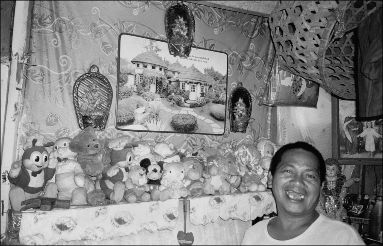 Man with Stuffed Animals Living Underground, South Super Highway, Manila, Philippines, November 2005