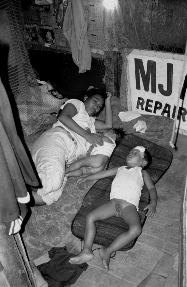 Family Resting Underground, South Super Highway, Manila, Philippines, November 2005