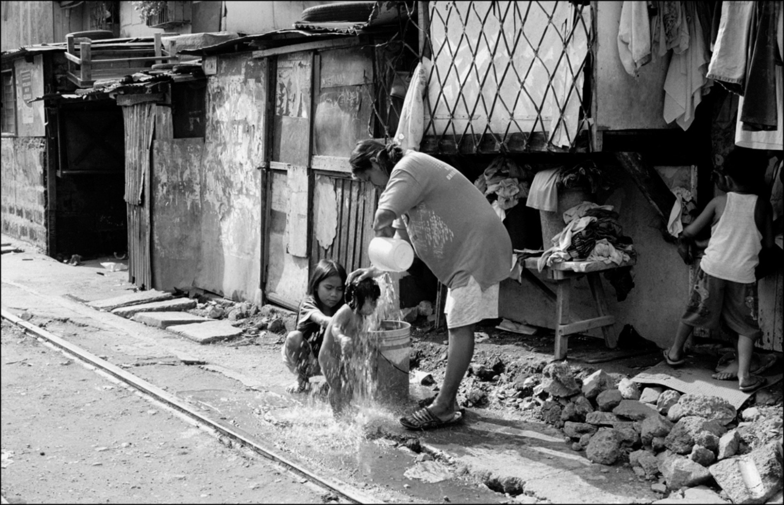Baby Being Washed, Santa Mesa Station, Manila, Philippines, November 2005