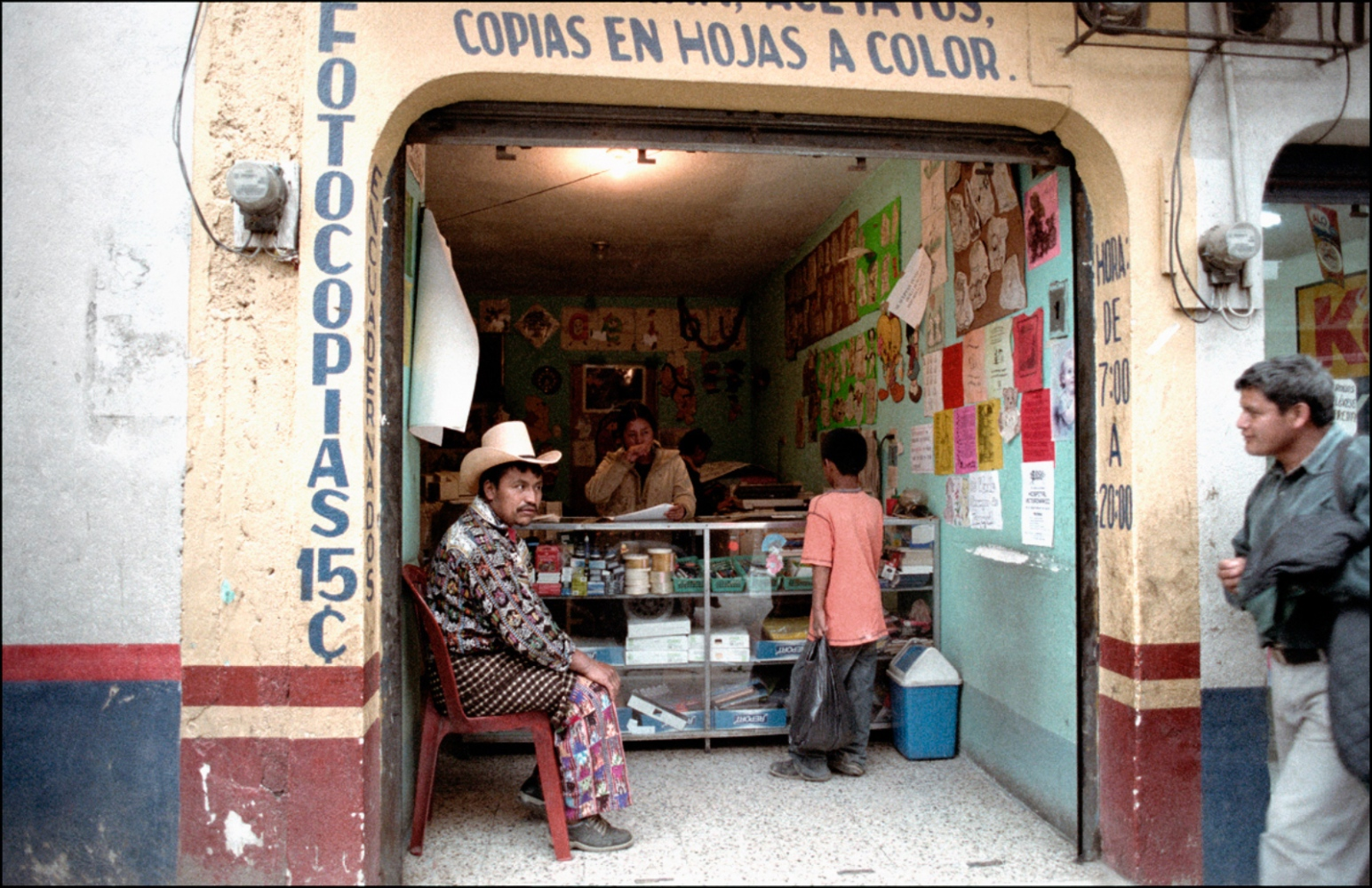 Man Sitting in Store Front, Solola, Guatemala, April 2006