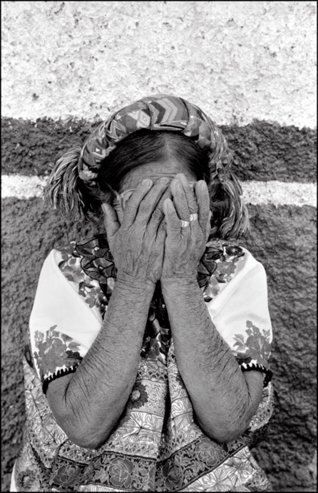 Woman Covering Face, Sacapulas, Guatemala, April 2006