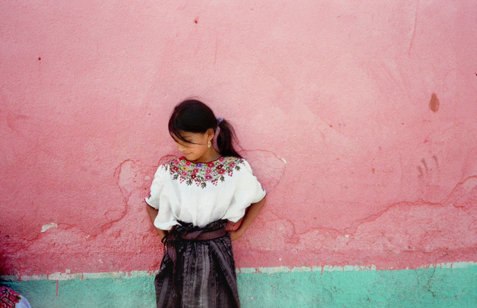 Girl Against Pink Wall, San Andres Itzapa, Guatemala, April 2006
