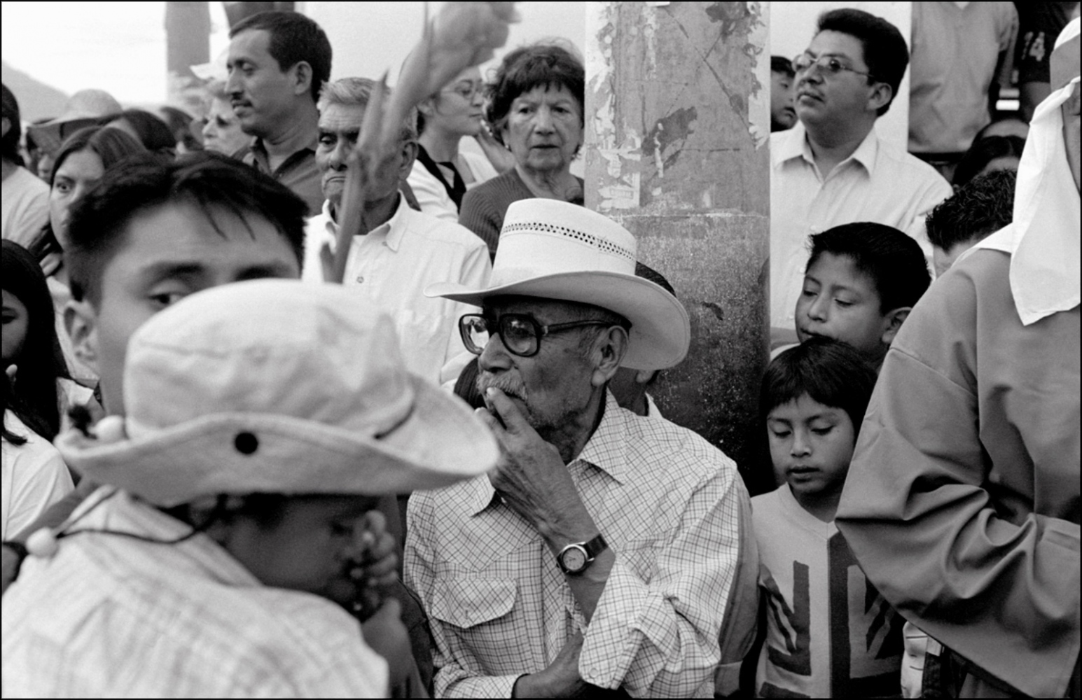 Man with Glasses in Crowd, Antigua, Guatemala, April 2006