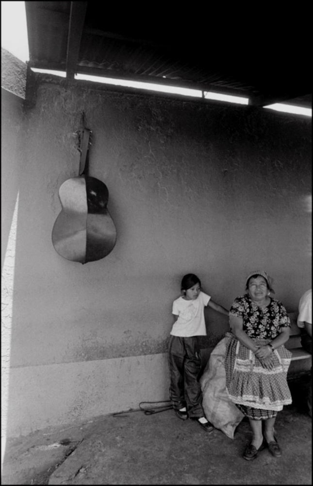 Guitar on Wall, Child and Lady, San Andres Itzapa, Guatemala, April 2006