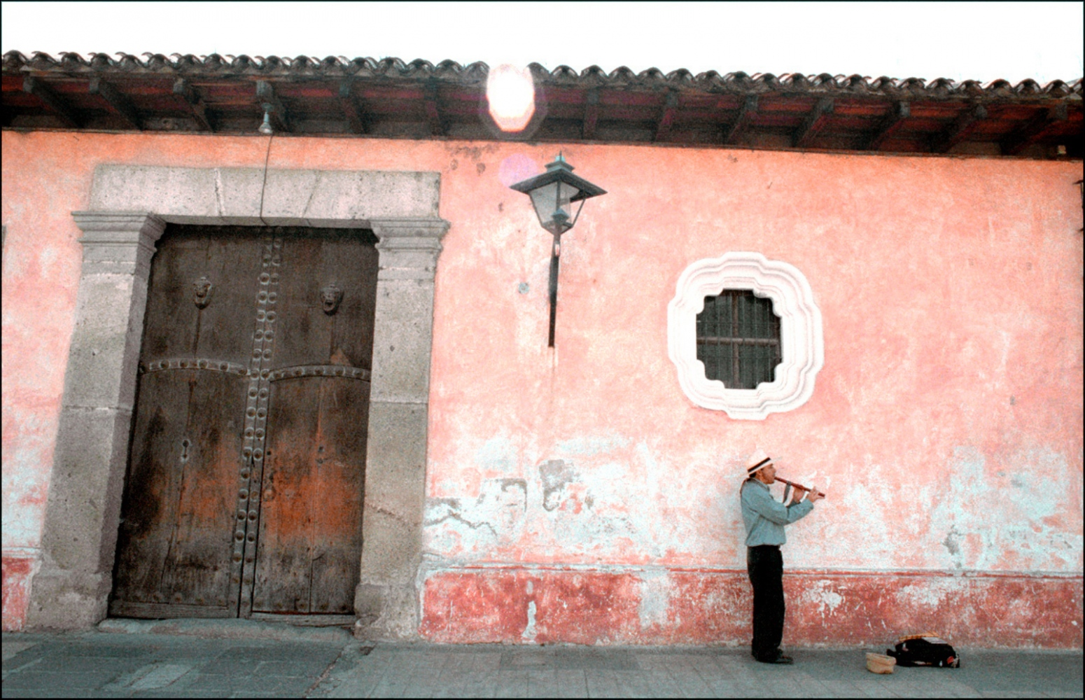 Man Playing Flute, Antigua, Guatemala, April 2006