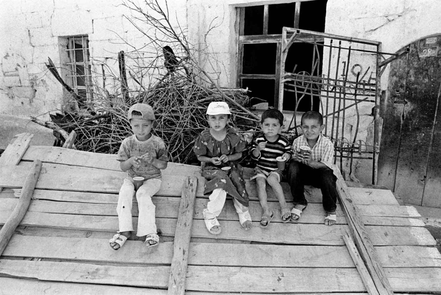 Children Sitting on Plank of Wood, Turkey, Summer 1997