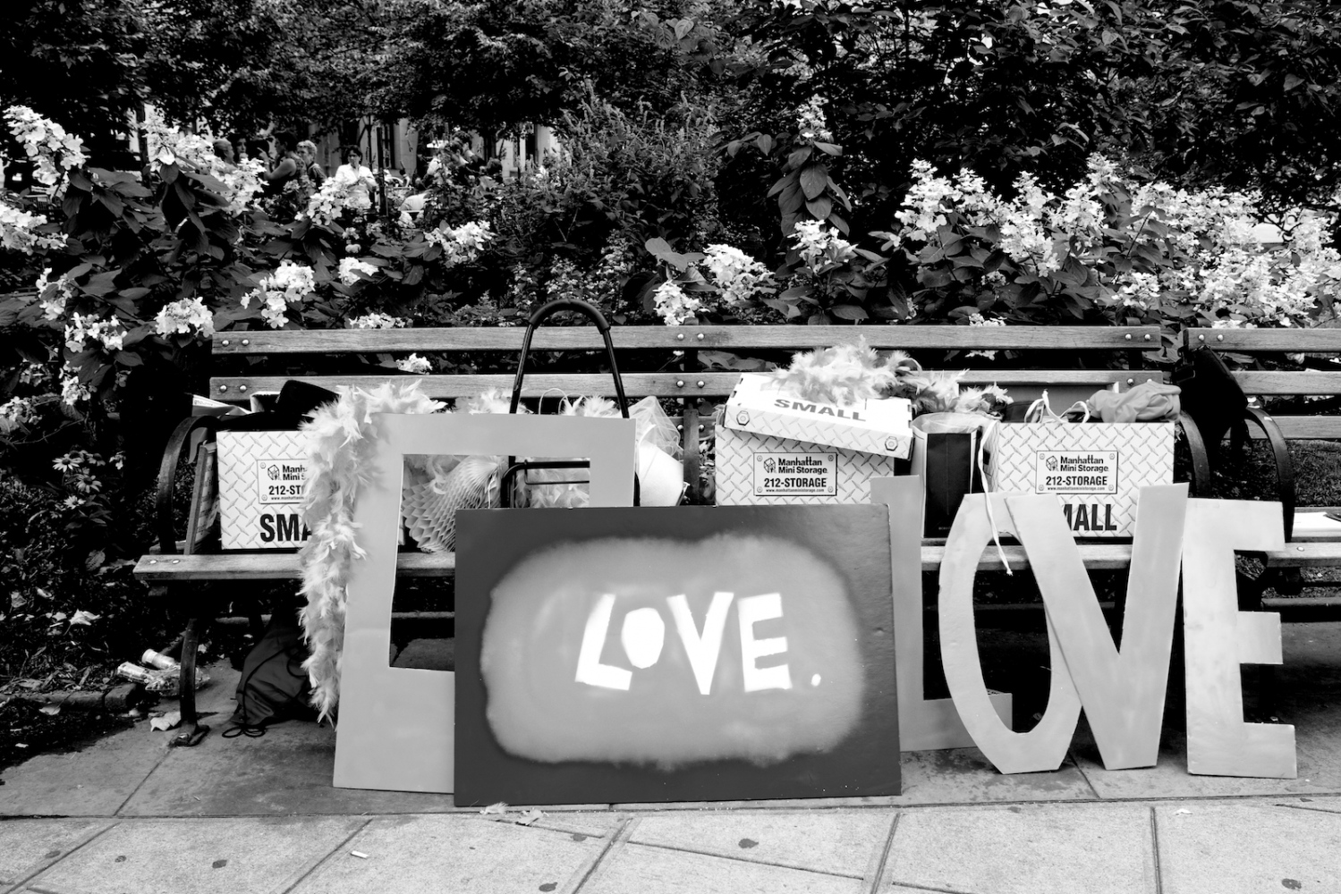 """Love"" signs by a bench, outside the Manhattan City Clerk's office, on the first day New York State's Marriage Equality Act goes into effect. New York, NY, July 24, 2011"