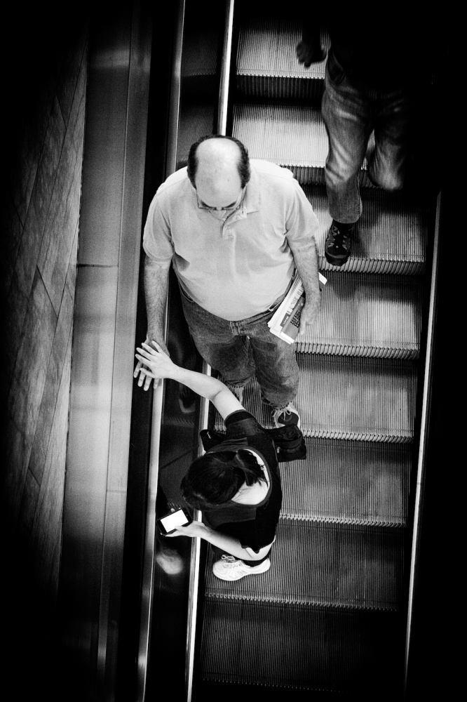 Commuters and tourists ride the escalator down to the trains at Grand Central Terminal, New York, NY.