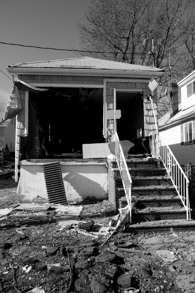 A damaged house stands in New Dorp Beach, Staten Island, N.Y. on Nov. 9, 2012. New Dorp Beach was devastated by Hurricane Sandy and now faces the long road to recovery.