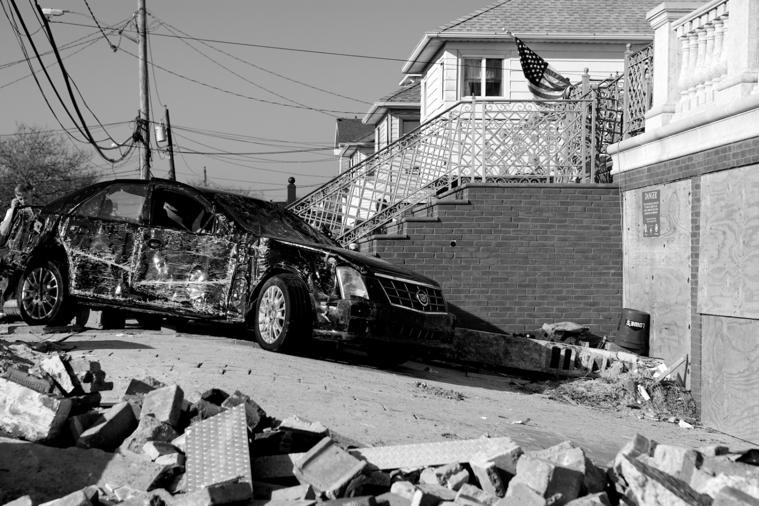 A car destroyed by Hurricane Sandy sits in front of a home in Breezy Point, Queens, N.Y. on Nov. 11, 2012.