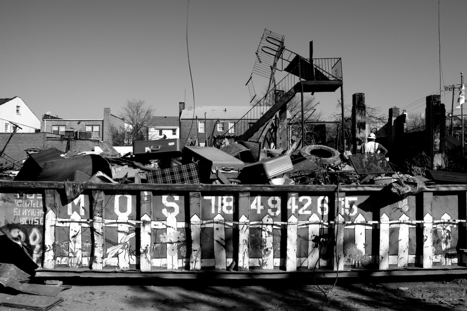 A dumpster that contains personal effects, furniture and other possessions from people's homes that were devastated by Hurricane Sandy sits in Breezy Point, Queens, N.Y. on Nov. 11, 2012. The tiny beachfront town, with many firefighters as its residents, was told to evacuate before Hurricane Sandy hit New York. Rising sea water made its way into electrical systems causing a fire that destroyed more than 120 homes.