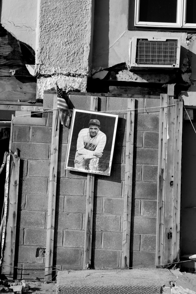 A photo of Babe Ruth hangs outside a house damaged by Hurricane Sandy in Breezy Point, Queens, N.Y. on Nov. 11, 2012.