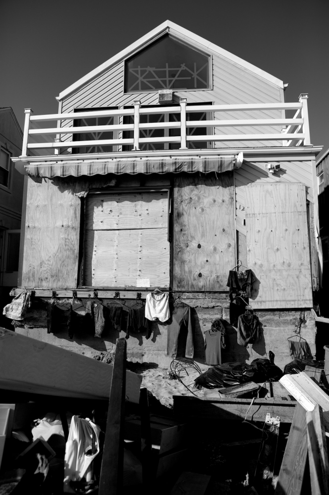 Clothes hang to dry outside a house damaged by Hurricane Sandy in Breezy Point, Queens, N.Y. on Nov. 11, 2012.
