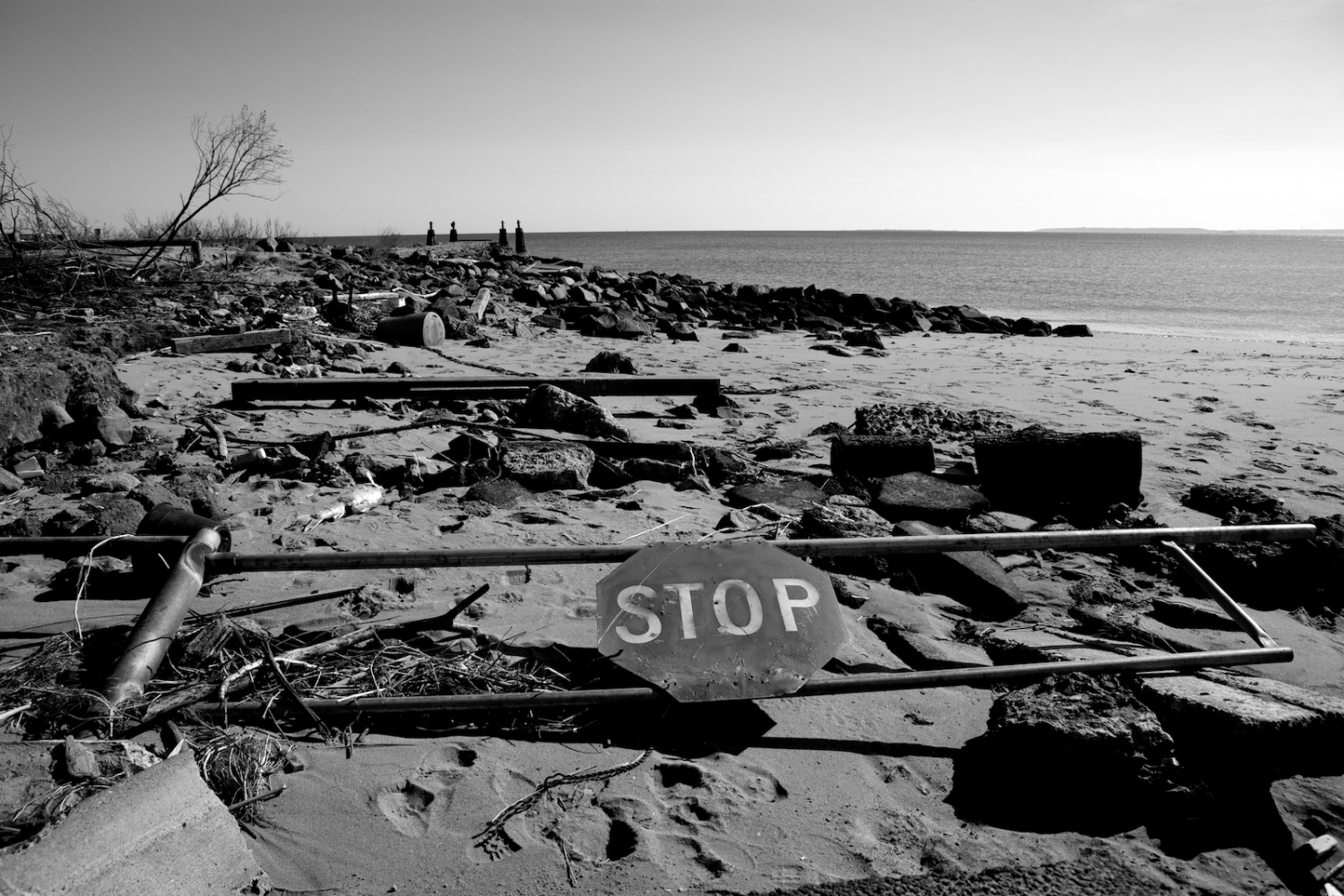A STOP sign lays on the beach in New Dorp Beach, Staten Island, N.Y. on Nov. 9, 2012. New Dorp Beach was devastated by Hurricane Sandy and now faces the long road to recovery.