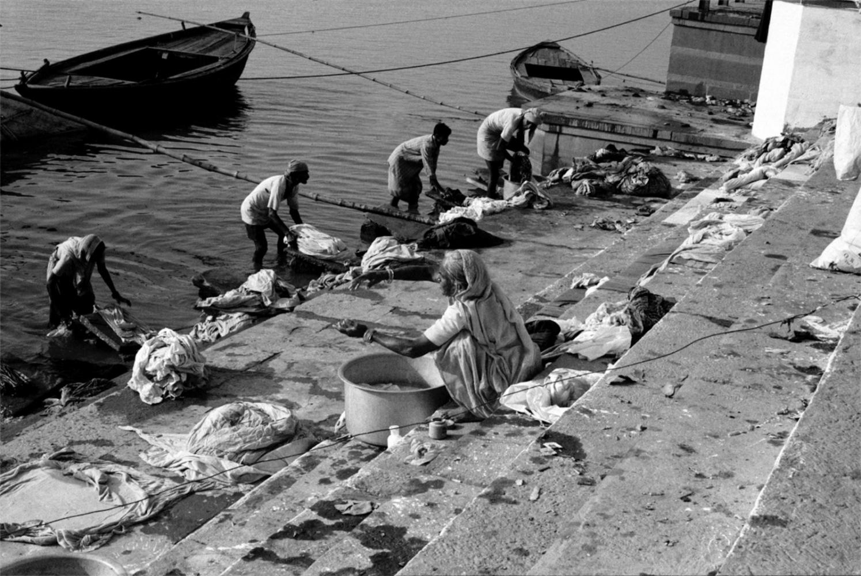 Lady and Laundry by Ganges, Varanasi, India, November 2003