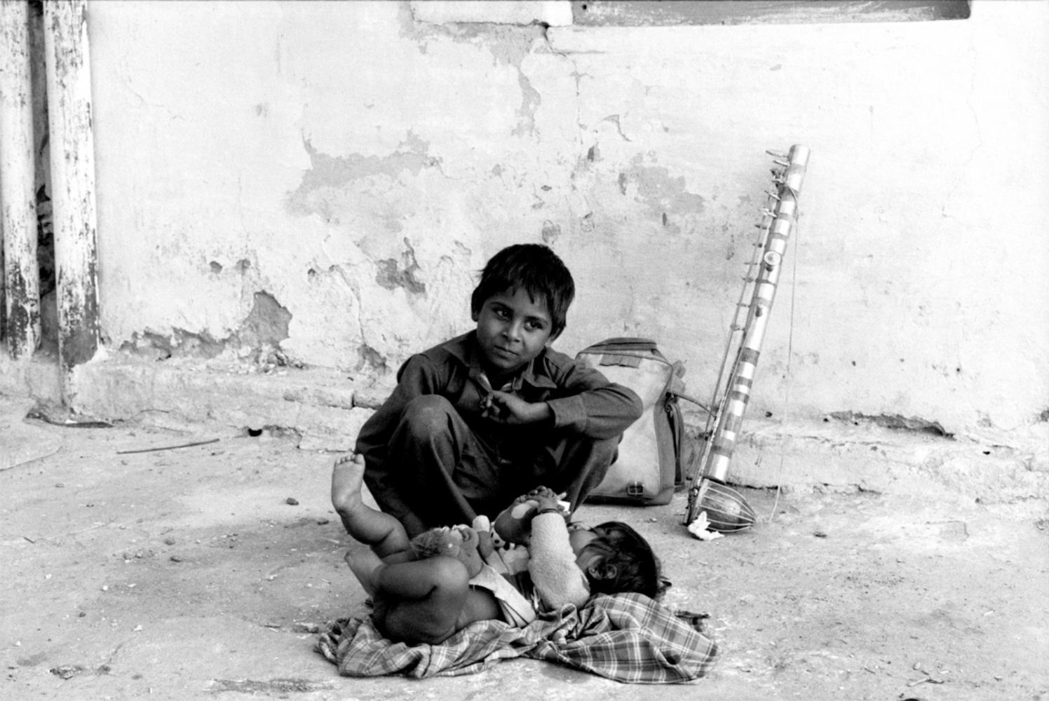 Boy, Baby and Music, Pushkar, India, November 2003