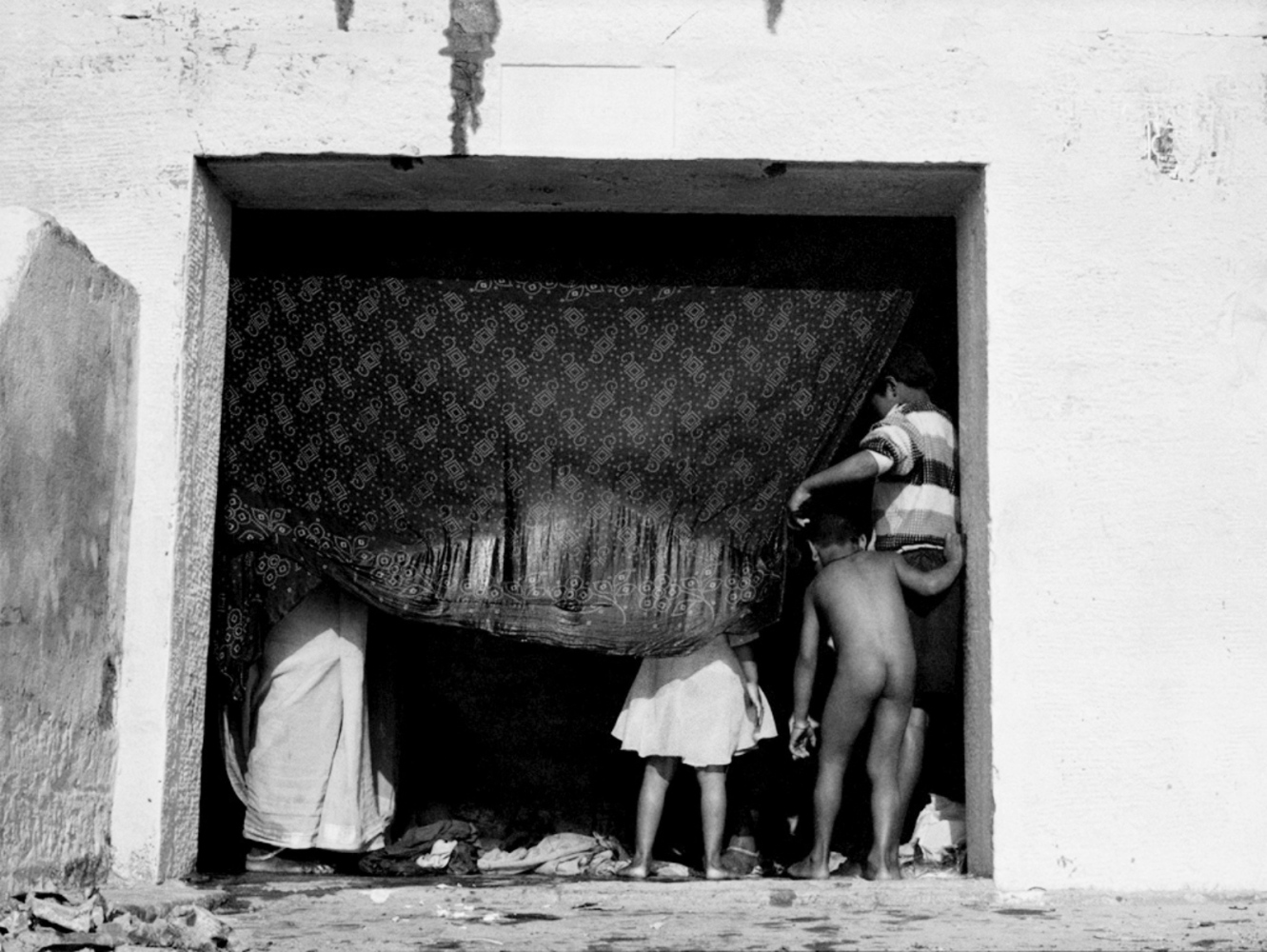 Child's Bum in Doorway, Varanasi, India, November 2003