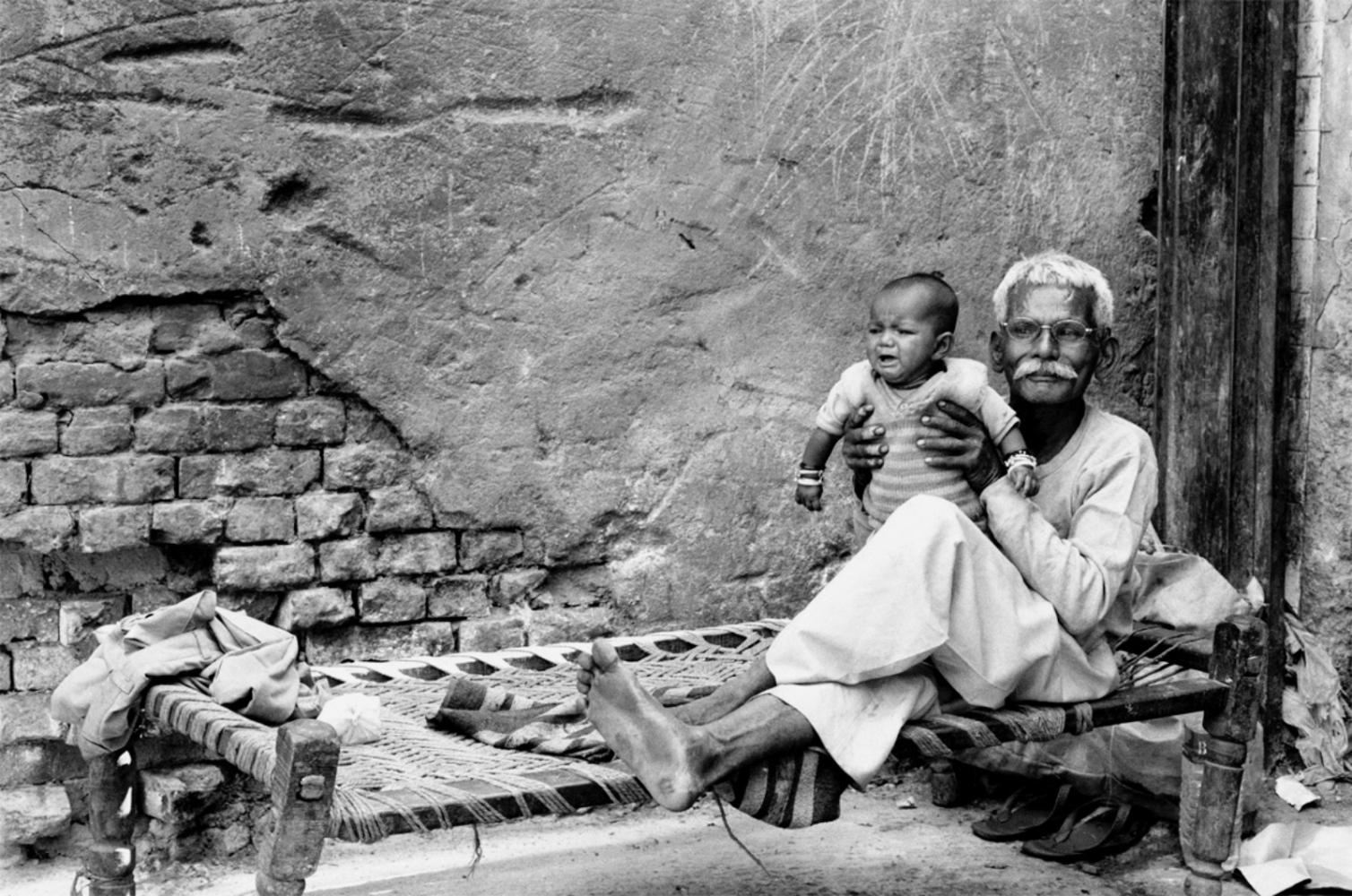 Man Holding Baby, Varanasi, India, November 2003