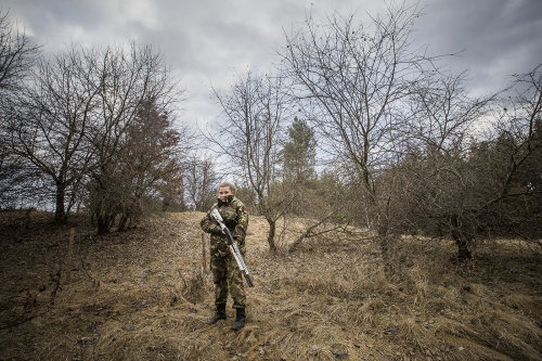 """Ana 21 years old,is a volonteer training at the Marussia Batalion (right sector) in Kievska Oblast, close to Kiev.  She is a sewer in an atelier in Kiev. She try to come here as much as possible """"because it's important to be prepared for anything could happen. But is very hard""""."""
