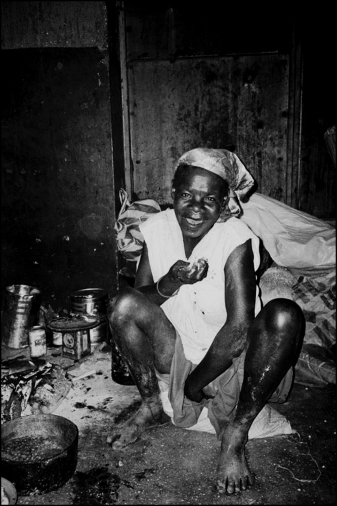 Crouching Lady with Food, Kuito, Angola, July 2000