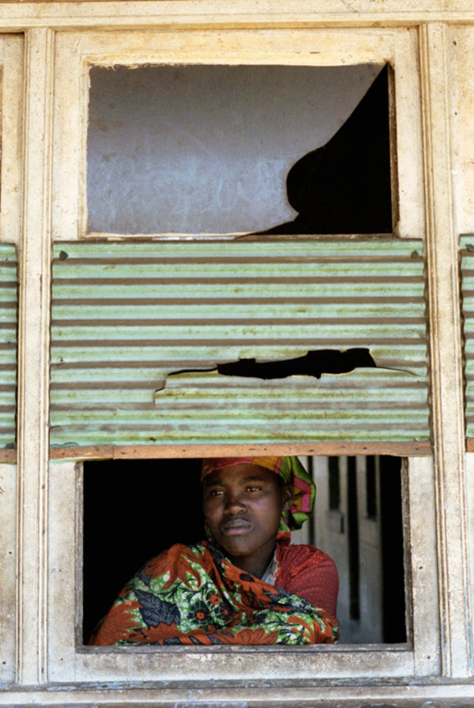 Lady in Window, Cuando, Angola, July 2000