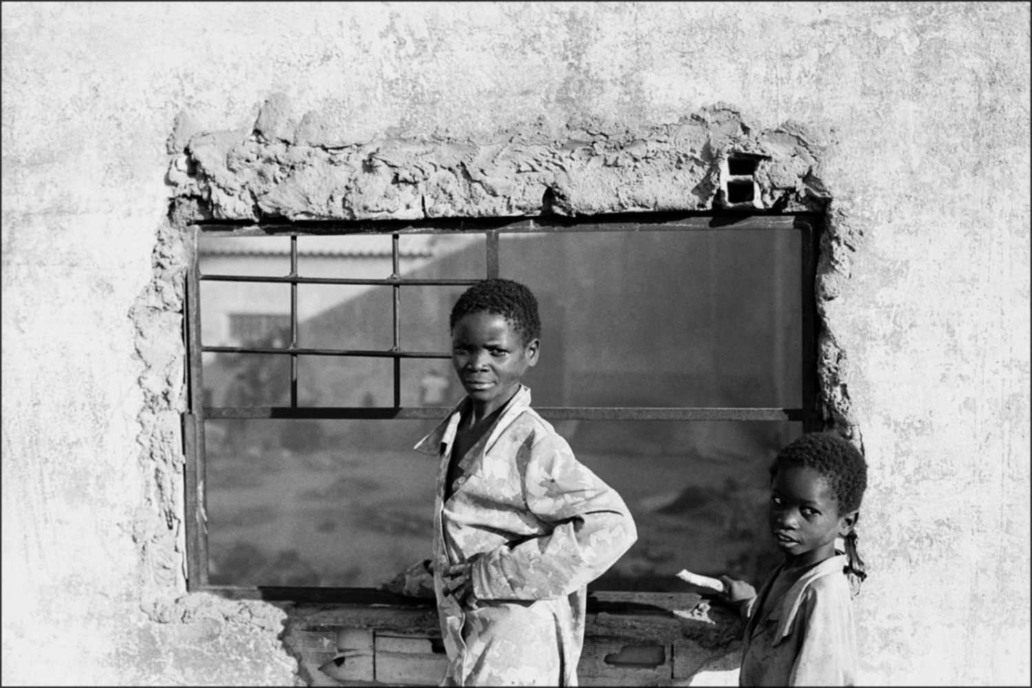 Two Boys Framed by Rubble, Caala, Angola, July 2000