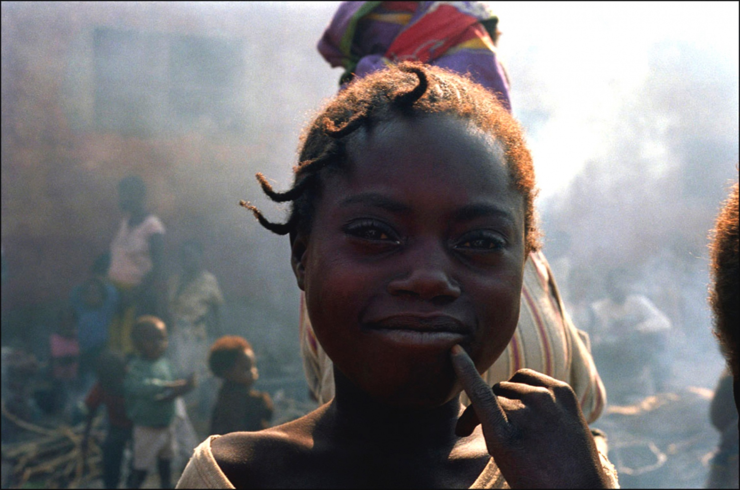 Smiling Girl with Pinky, Caala, Angola, July 2000