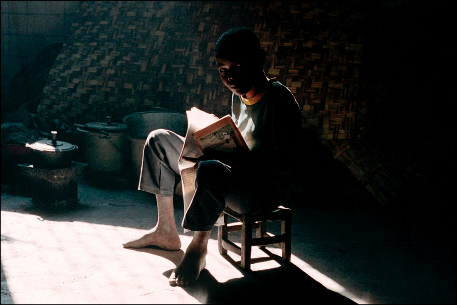 Boy Reading, Sun Rays, Caala, Angola, July 2000