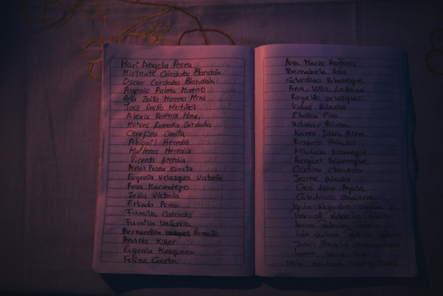 A notebook used during the mass for the remembrance of the dead ones contains names written by friends and relatives of the people who have recently died and of those who died during the 2nd of May massacre.