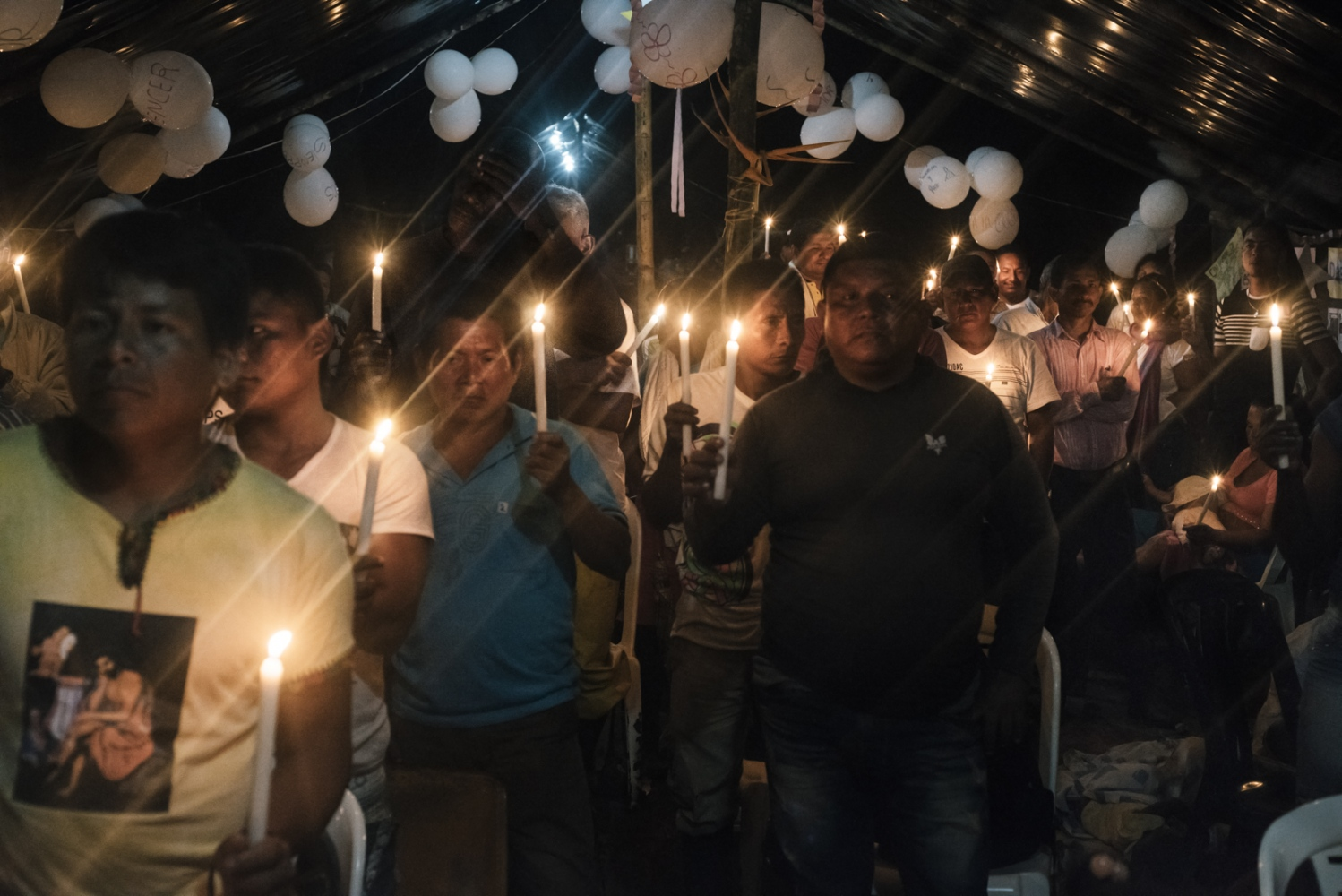 "Afrocolombians and members of the Embera community observe a minute of silence during the FARC's vigil for peace on October 31st 2016. The vigil opened the door of all of the FARC camps to civilians and anyone who wanted to attend, it was organized by the FARC to reiterate their willingness to keep negotiating with the government after the ""NO"" won in the ""Plebiscite for the peace"" on October 12th. In Chocó only 10 percent of the land is owned by privates, the other 90 percent are commons that belong to black communities, indigenous reservations and are inalienable, imprescriptible and undistrainable."