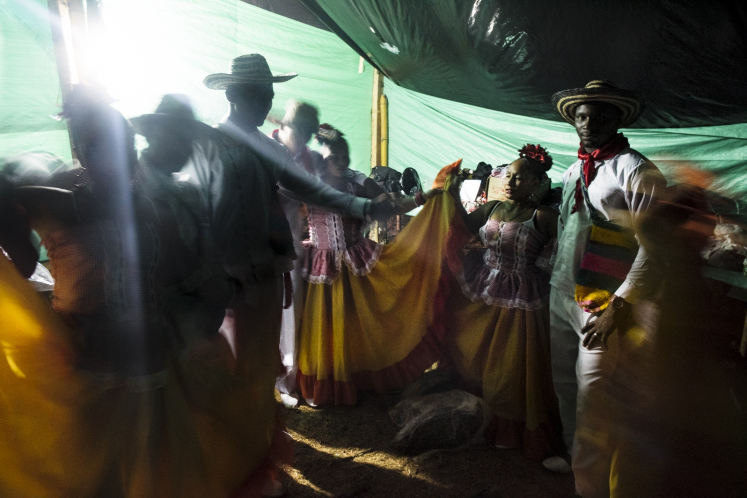 FARC members dressed in traditional dresses, rehearse before going on stage and dancing for the communities of Bojayà.