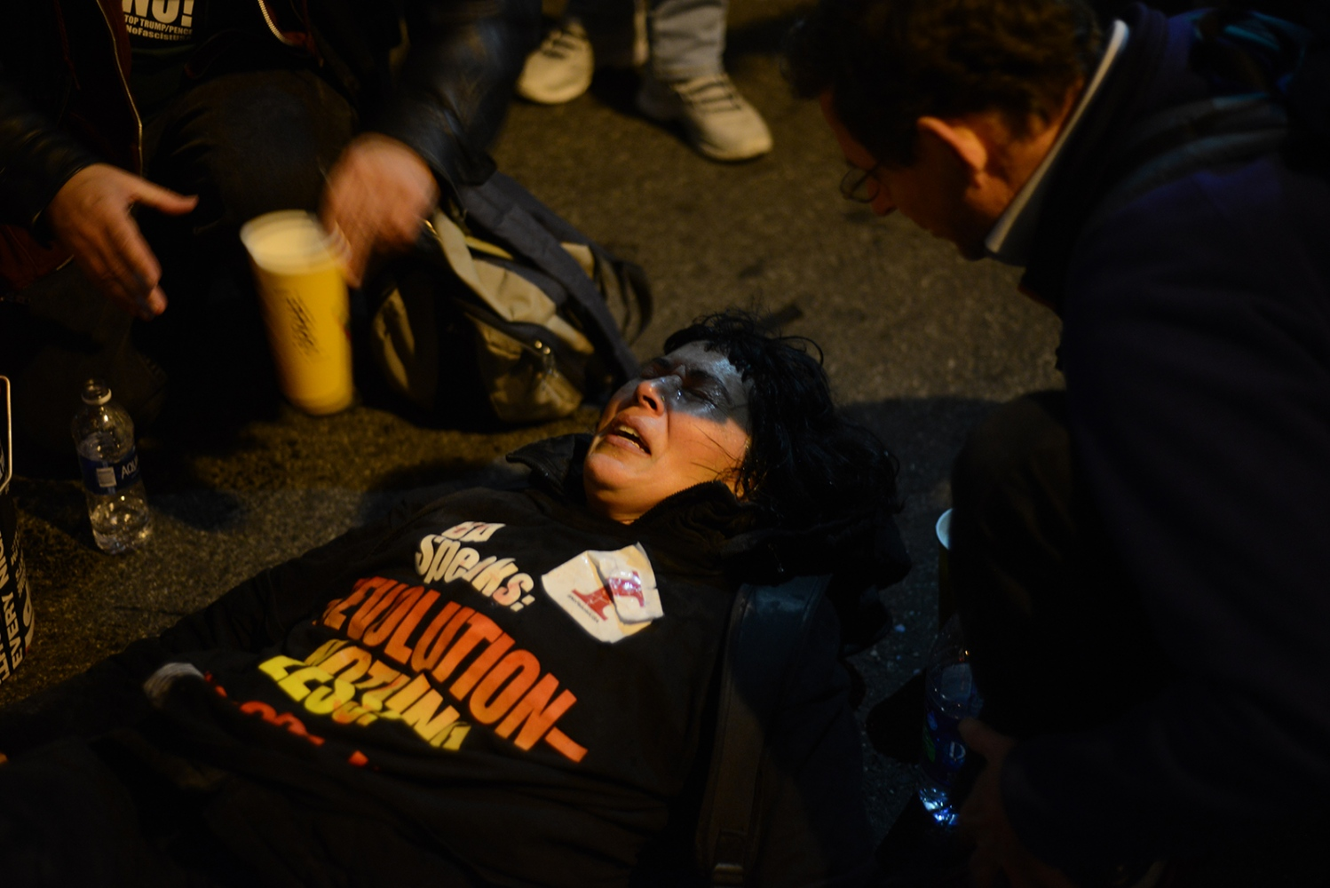 A protester receives medical attention after being tear gassed at a march against fascism in DC the eve before Donald Trump's Inauguration. January 19th, 2017