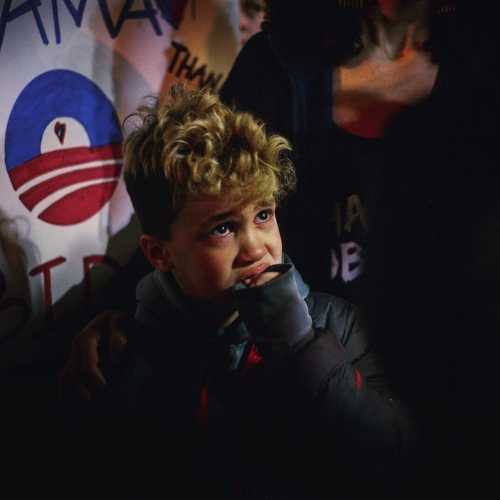 "A child at a ""Thank you Obama"" rally outside the White House January 19, 2017 starts to cry when a Trump supporter angrily attempts to provoke those gathered."