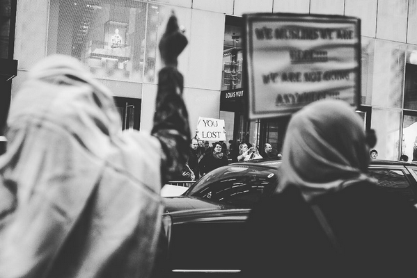"Scenes from 5th Avenue: Two Muslim women attend their first protest after the election of Trump . Across the street a man holds a sign that reads ""You lost"". ""Someone came up to me and said we were welcome - it brought tears to my eyes,"" said one of the friends, Mekia. ""Many in my community are afraid to come out but we need to be here. We have had young ladies in our mosque have their hijab torn from their head. It's offensive and affects the entire community. I may worship a little different but I am an American,"" says the other friend, Bibi.  New York City, November 13th, 2016"