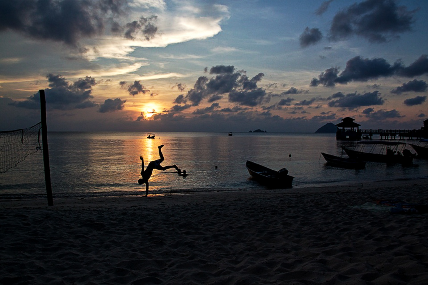 Perhentian Kecil, MALAYSIA, April 26, 2011: A man practices Capoeira at Coral beach.