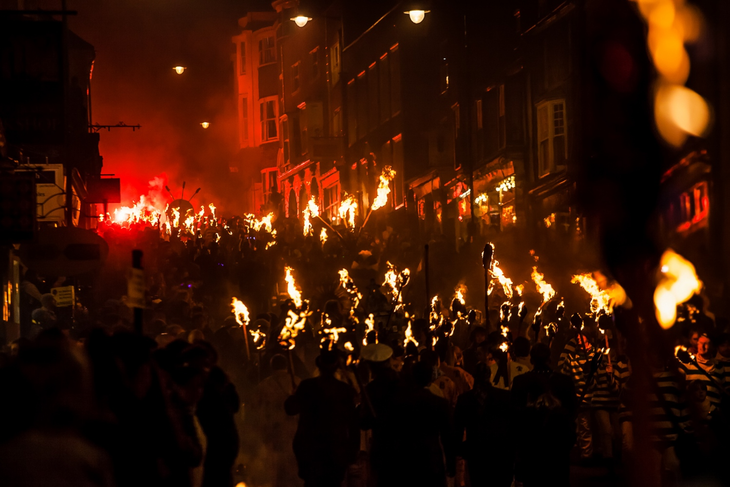 Lewes, UK, November 5, 2012: Parttakers in the yearly Lewes Bonfire parade walk through the streets with torches to comemmorate Guy Fawkes Night.