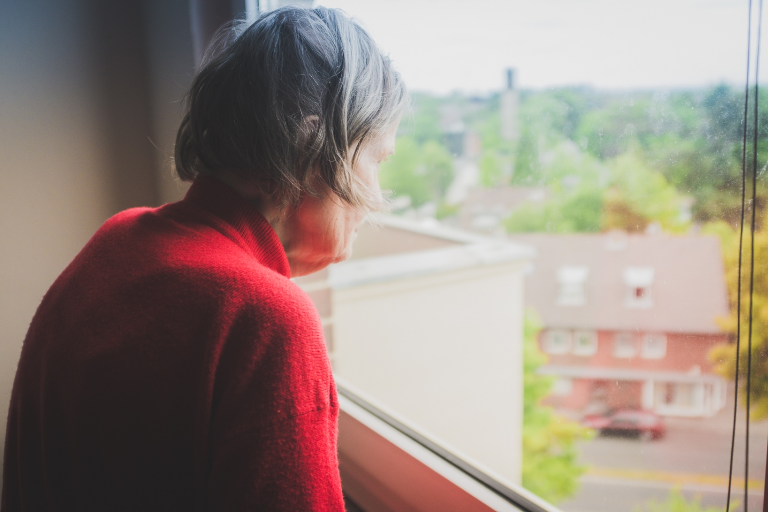 'State of mind'. Helga looking out of her living room window. This day Helga was moved out of the apartment in which she had lived in for 55 years, to be admitted into a closed medical facility. Neuss, GERMANY, May 29, 2015.