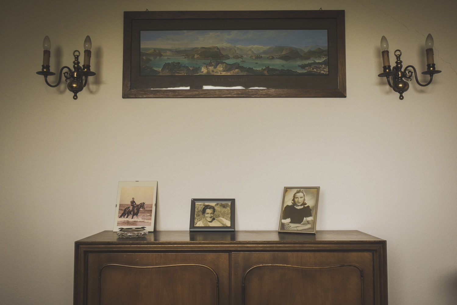 'Family photographs'. Family photographs in Helga's living room. The picture on the right shows Helga as a 27 year old woman, the pictures show her late husband. Neuss, GERMANY, May 29, 2015.