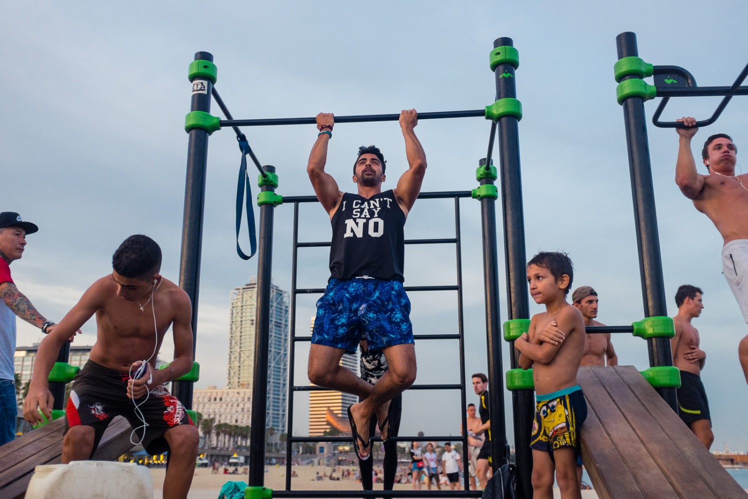 Barcelona, SPAIN, September 4, 2016: Street Workout/ Calisthenics scene at Barceloneta beach.