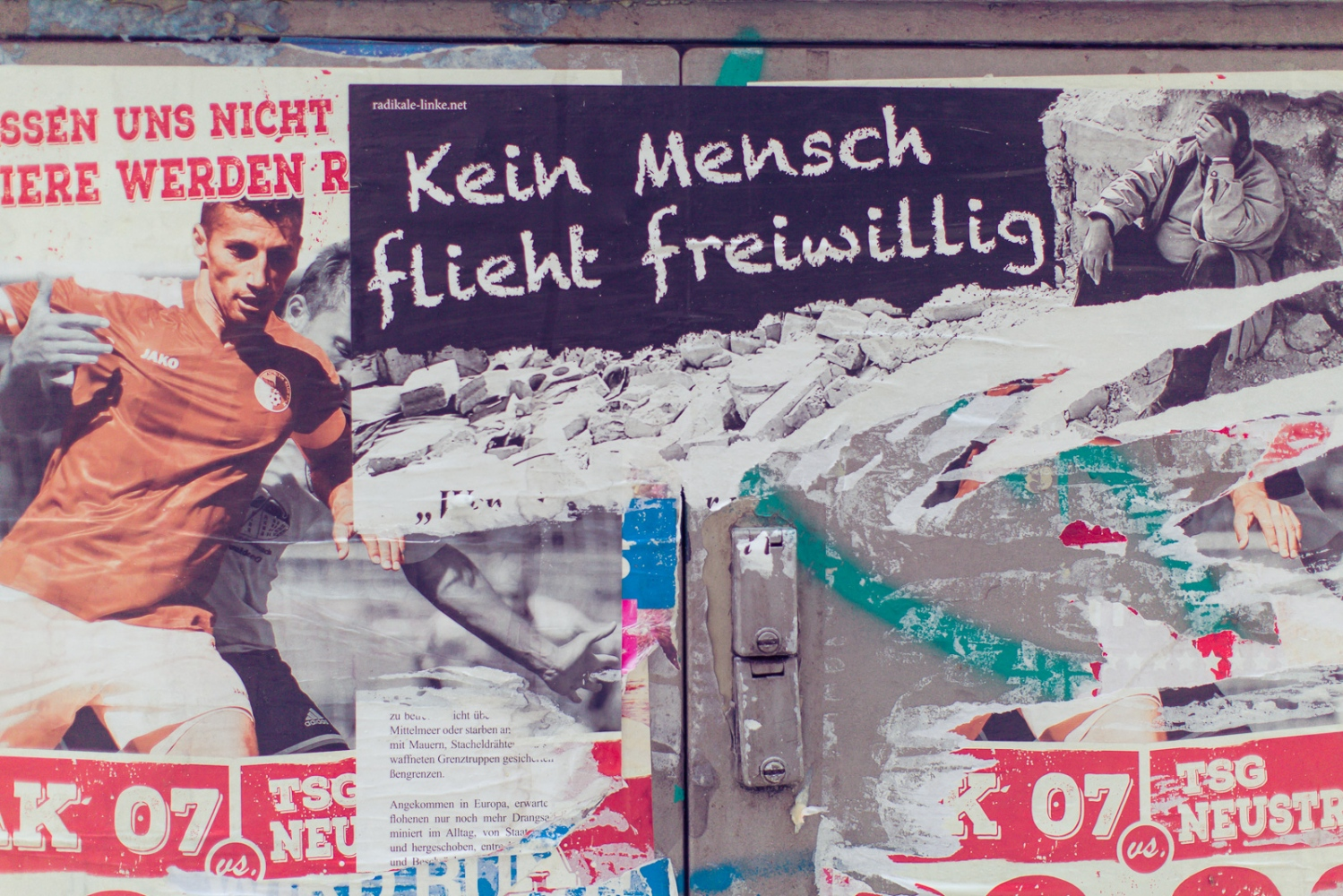 "Berlin, GERMANY, September 9, 2015: A poster pasted next to LaGeSo (regional office for health and social affairs) reads ""Kein Mensch flieht freiwillig"" (Engl. ""nobody is a refugee by free will"")."