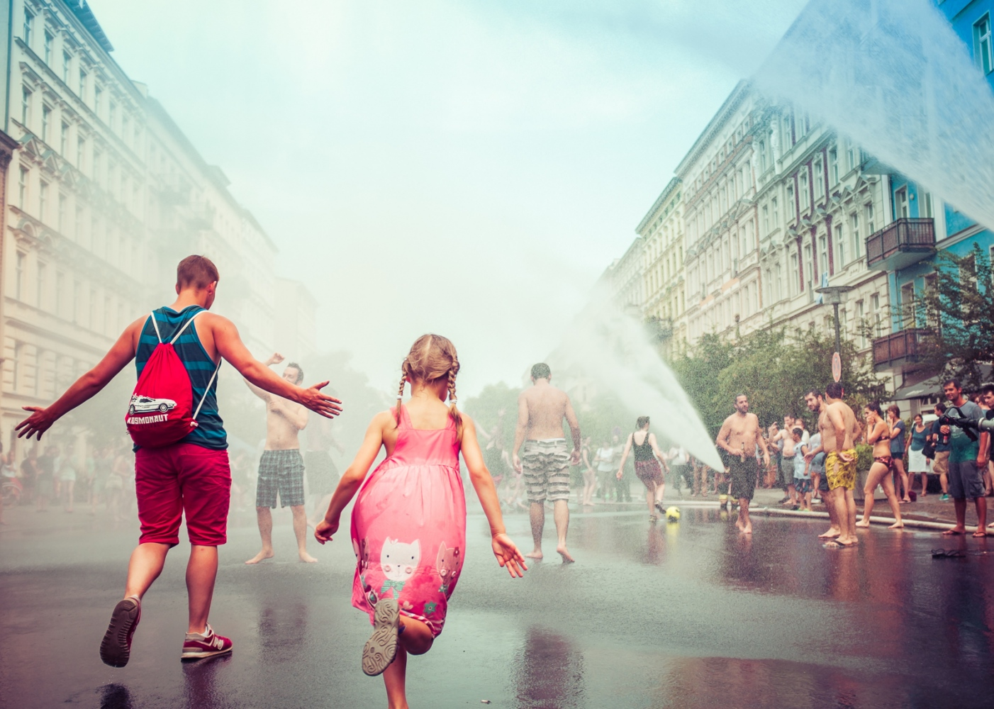 Berlin, GERMANY, July 6, 2015: Fire fighters start a water party in Oderberger Strasse in Prenzlauer Berg district during a hot day.