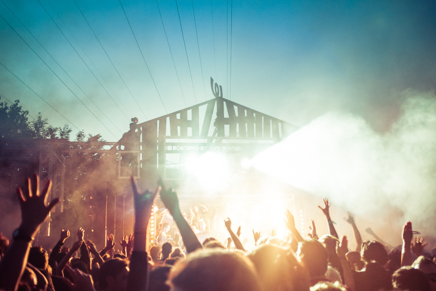 Berlin, GERMANY, July 26, 2015: Crowds celebrate electronic dance music and sunshine at Watergate Open Air. Rummelsburg is one of the most popular outdoor event venues during summertime in Berlin.