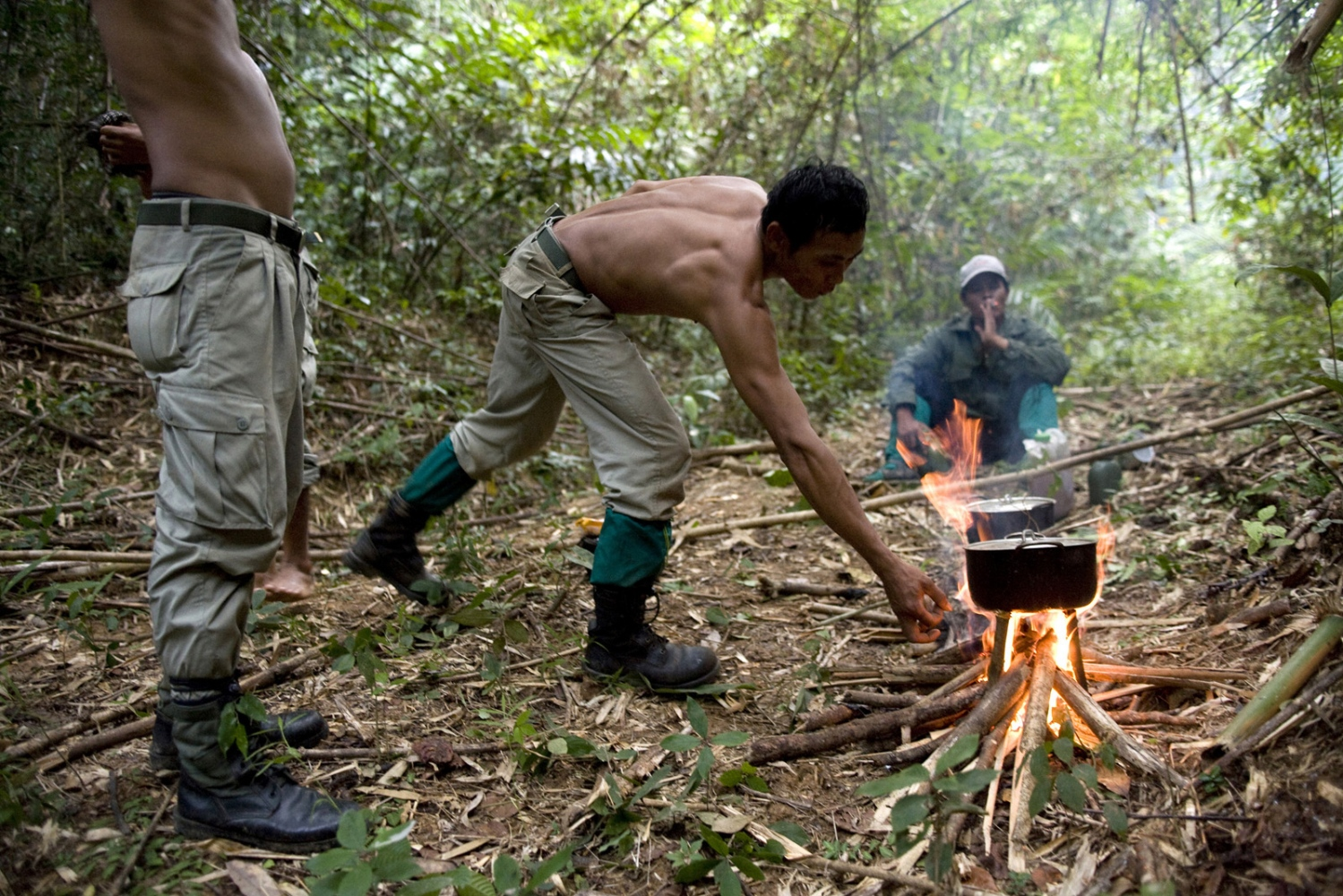 Rangers make a camp whilst on patrol in the forest. The forest rangers are employed by the Ministry of Environment but sponsored by Flora and Fauna International who pays them 75% of their salary and provides training and accommodation. They undertake regular patrols in to the Samkos Wildlife Sancturary which is part of the Cardamom Mountains Nature Reserve looking for illegal activites such as logging, poaching, land encroachment and the production of the illegal substance sassafras oil.