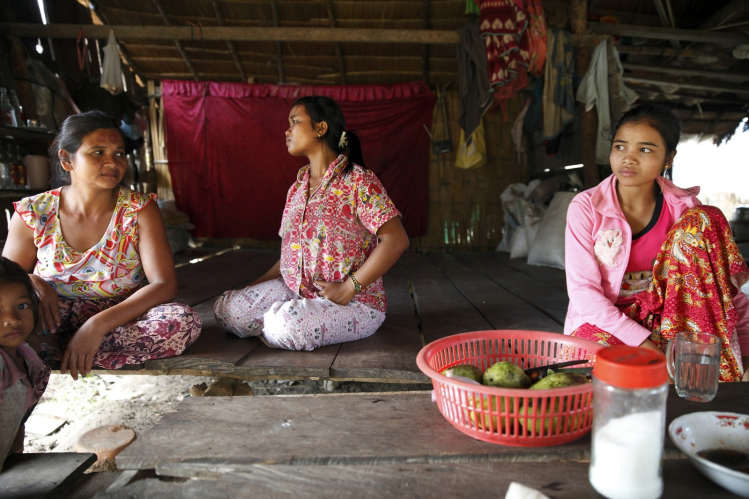 Cambodian women sit in a small shop in the Areng Valley.
