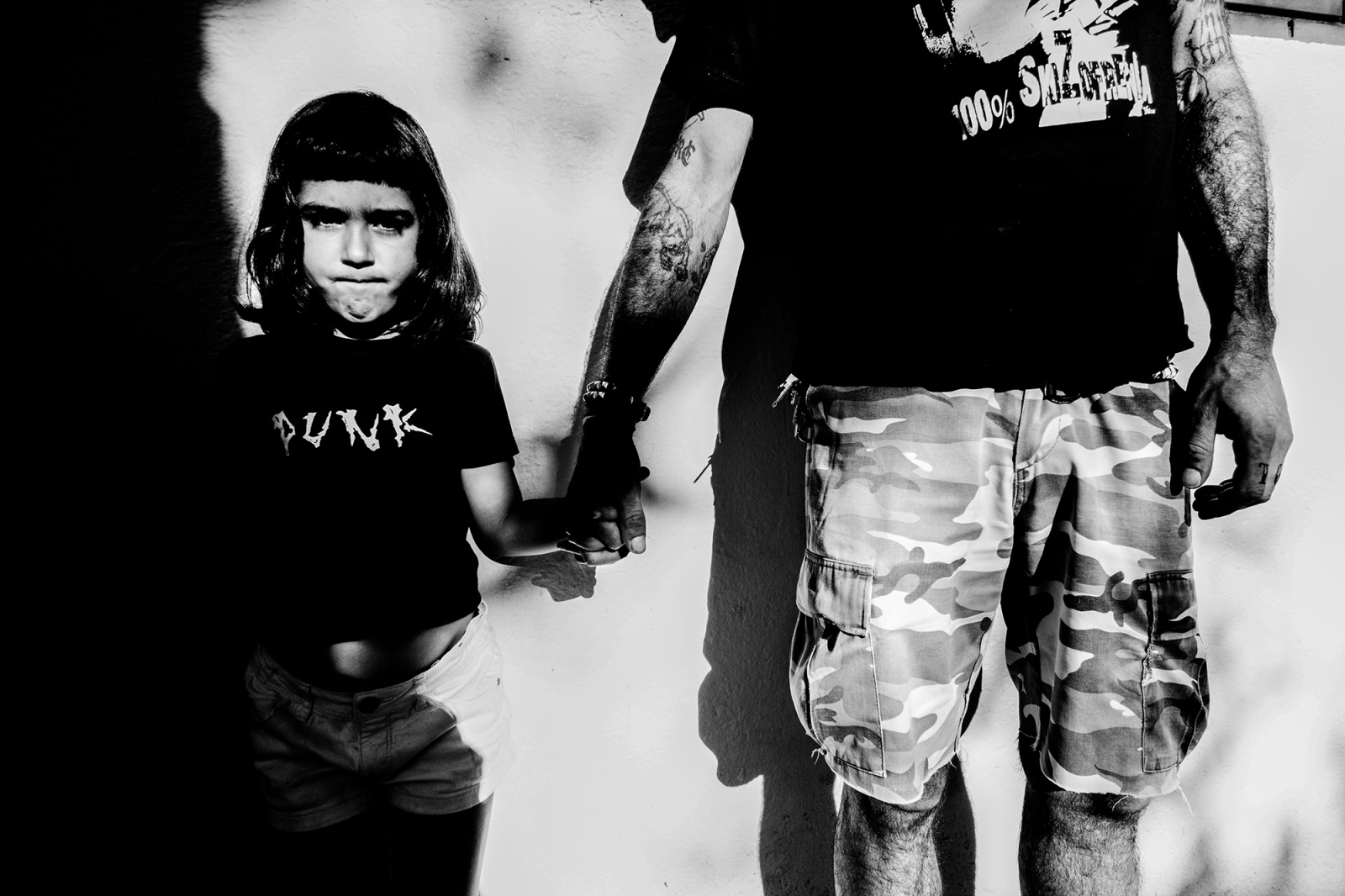 Father and daughter posing. I wanted to tell stories of punkis with children starting from young people in punk philosophy.